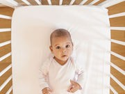 Baby Crib Ads Show Unsafe Practices, Study Says